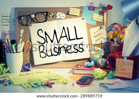 Small Business / Small business concept on bulletin board in office