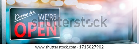 Small Business Store Front With 'Come In We're Open' Sign Hanging On Window - Small Business Concept Photo stock ©