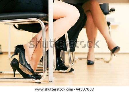 ... office meeting working together - only feet under the table to be seen