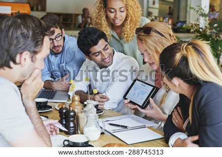 Small Business team meeting global sharing economy tablet touchscreen cafe