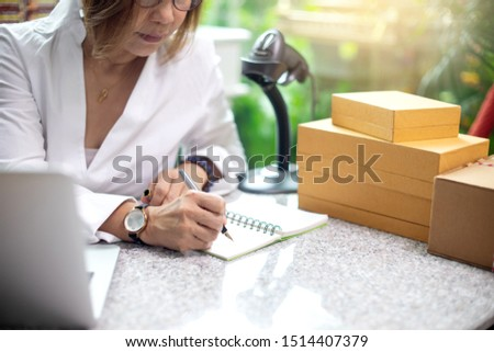 Small business woman Worker delivery service and working packing box, business owner working checking order to confirm before sending customer in post , Shipment Online with barcode scanner clipboard. #1514407379
