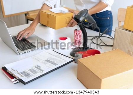 Small business Worker  delivery service and working packing box, business owner working checking order to confirm before sending customer in post office, Shipment Online Sales #1347940343