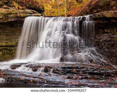 Small but picturesque waterfall at Indiana's McCormick's Creek State Park in autumn
