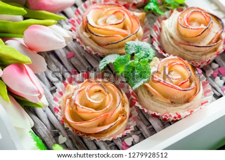 Small cakes made of apple and puff pastry in the form of a rose