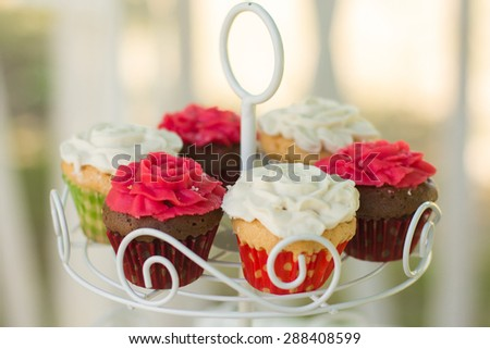 Small cakes with different stuffing. Many tiny cakes with strawberry, whipped cream, jelly and mint