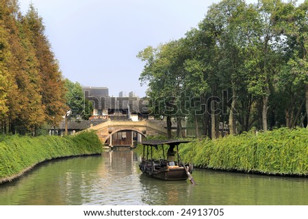 Small canal with boat at the watervillage Wuzhen near Shanghai,China