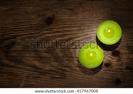 Small candles on wooden background