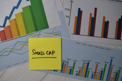 Small Cap write on sticky notes isolated on Office Desk. Stock market concept