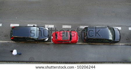 Small car uses little space for parking. Concepts like clever, small cars, parking troubles or abstracts like the smaller the better.