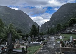 Small catholic cemetery in Urdos, French Pyrenees, in a rainy day of spring.