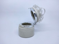 Small ceramic craft or container for storing jewelry.  This ceramic is generally a wedding souvenir.