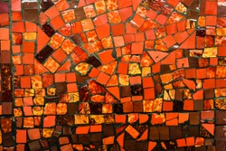Small ceramic mosaic. Abstract background, glossy texture of mosaic tiles on the wall. Custom-sized red mosaic tiles in the background. space for text.