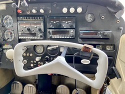 Small Cessna plane. The cockpit, the propeller and the landing gear of the light aircraft. Piston powered aircraft