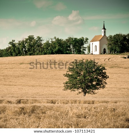 Small chapel with a meadow -colorized photo - stock photo