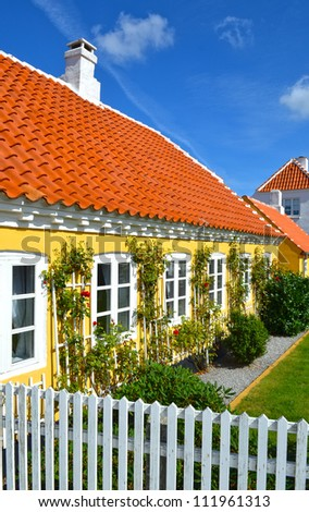 Small characteristic yellow house in the center of Skagen in jutland