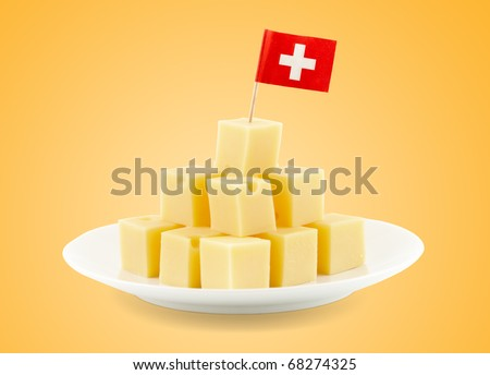 small cheese blocks with a swiss flag and clipping path