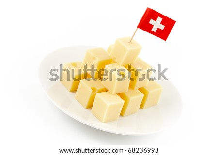 small cheese blocks with a swiss flag in it isolated on white