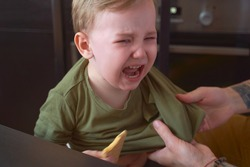Small child bitterly bursts in tears, capricious, has bad mood, takes out brain of parents, tearfully asks to play, yells, throws tantrums. Day, kitchen. Tired of quarantine, wants to go outside.