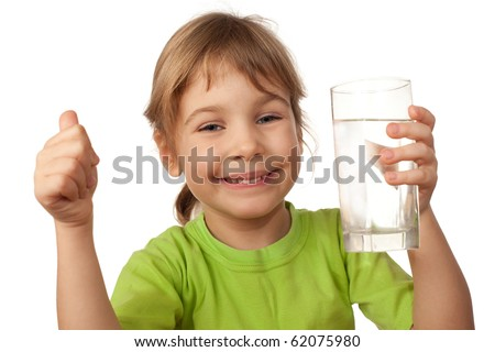 small child drink water from glass container