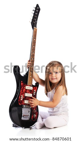 Small child hold red acoustic guitar. Music concept.