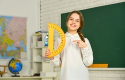 Small child holding ruler for mathematics lesson. Science and Technology. Cute little schoolgirl with geometrical tool for mathematics. Elementary school mathematics or maths. Mathematics matters.