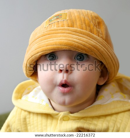 Small child in an orange cap - stock photo