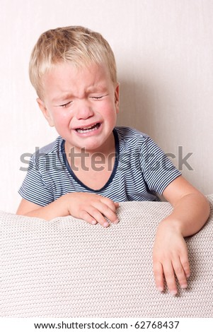 Small child is cry, indoor.