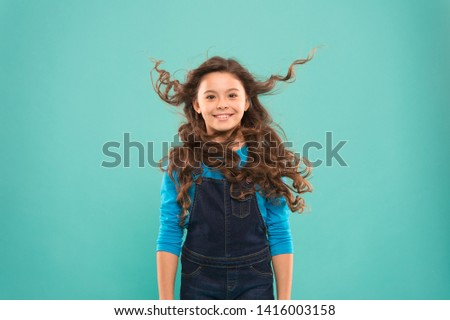 Small child long hair. Girl active kid with long gorgeous hair. Extra fresh dry shampoo. Fresh it up. Strong and healthy hair concept. Nice and tidy hairstyle. Easy tips making hairstyle for kids. #1416003158