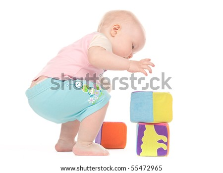 Small child playing with blocks on white background
