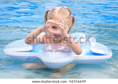small child swims in the sea