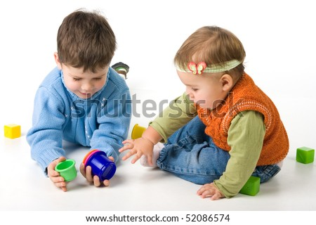 Small children play with toys