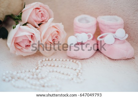 small children's pink shoes on a white background with an inscription love and flower. Pregnancy, care of the child, baby #647049793