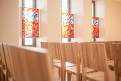 Small christian chapel or church in a hospital with colorful windows for a silent moment.