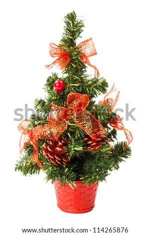 small christmas tree with bows and cones over white background