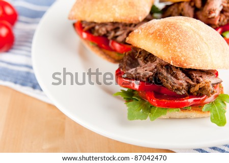 Small Ciabatta Sandwiches with Grilled Bell Peppers, Tomatoes, Arugula and Pulled Beef