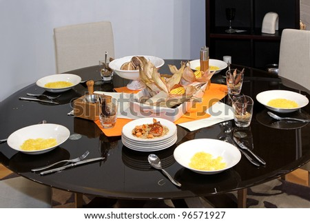 Small circle dinning table set up with festive food