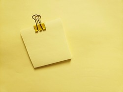 Small Clipped Empty Note Card on Yellow Sheet