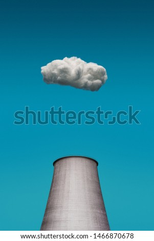 small cloud floating above the nuclear plant. Nuclear danger of factories.