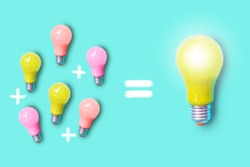 Small colorful light bulbs and plus sign on the left and a large yellow shiny light bulb on the right , represent synergy ,teamwork and collaboration for success output concept