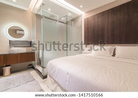 Small contemporary open-plan bathroom hotel room design. #1417510166