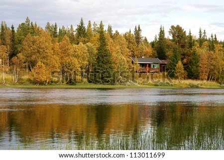 Small cottage by a lake