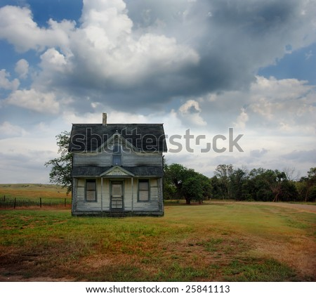 Small country farmhouse out on the prairie in South Dakota.