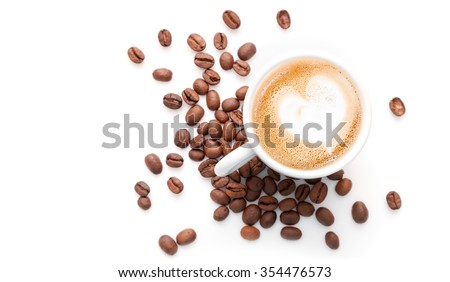 Small cup of cappuccino with coffee beans and heart shaped milk foam, top view isolated on white background #354476573