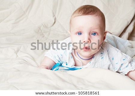 Small cute baby boy laying on blanket