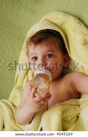 Small cute boy with bottle in hand