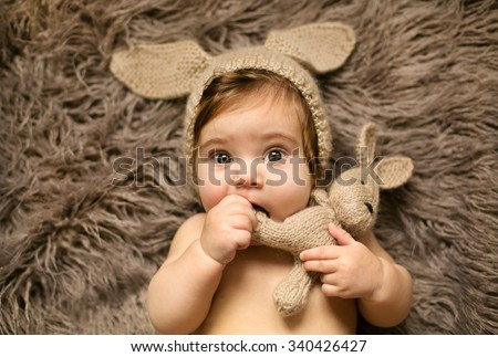 Small cute girl playing with her favorite rabbit toy
