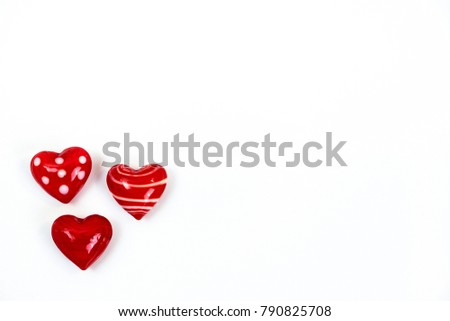 Small cute red heart figurines made of glass isolated on white background #790825708