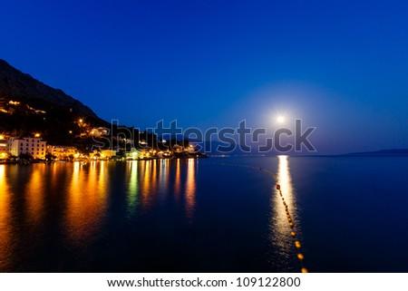 Small Dalmatian Village and Adriatic Sea Bay Illuminated by Moon, Croatia