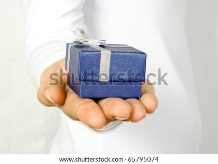 Small dark blue gift in a female hand