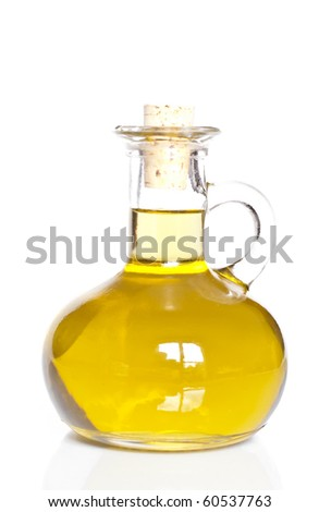 Small decanter with olive or sunflower oil isolated on the white background